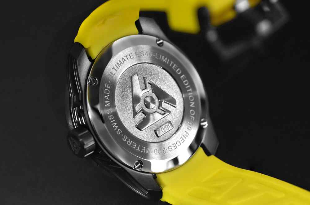 black and yellow swiss sports watch case back
